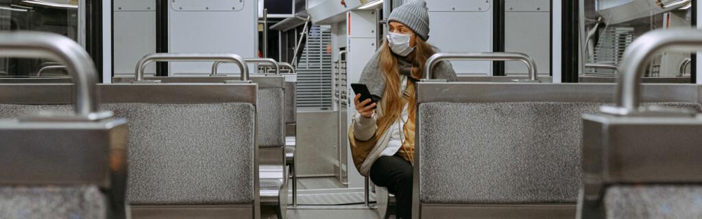 Woman wearing mask on a train
