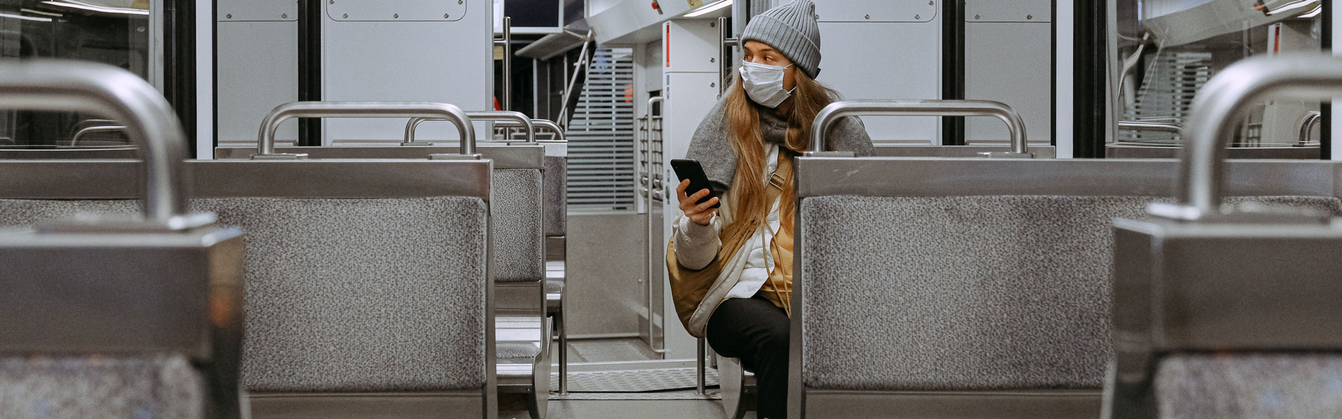 Woman wearing mask on a train