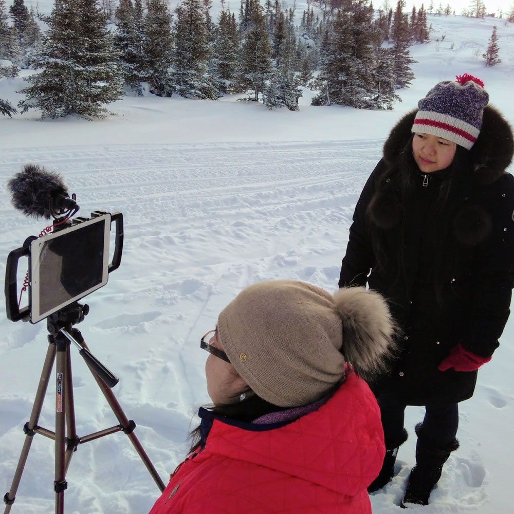 Christine Ha filming in Northern Quebec